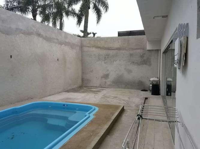 CASA 3 QUARTOS (1-SUÍTE E 2-DEMI) COM PISCINA Á VENDA NA PRAIA CENTRAL DE GUARATUBA