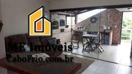 Casa em condomínio com piscina no Portinho