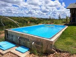 Casa com excelente vista a venda no Condomínio Recanto do Riacho em Funilândia MG